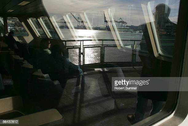 Passengers ride a Washington State Ferry from Bainbridge Island into port December 14 2005 at Seattle Pier 52 in Seattle Washington Teams of...
