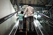 Passengers ride an escalator at Mantri Sampige Square Metro station operated by Bangalore Metro Rail Corp in Bengaluru India on Sunday May 3 2015...