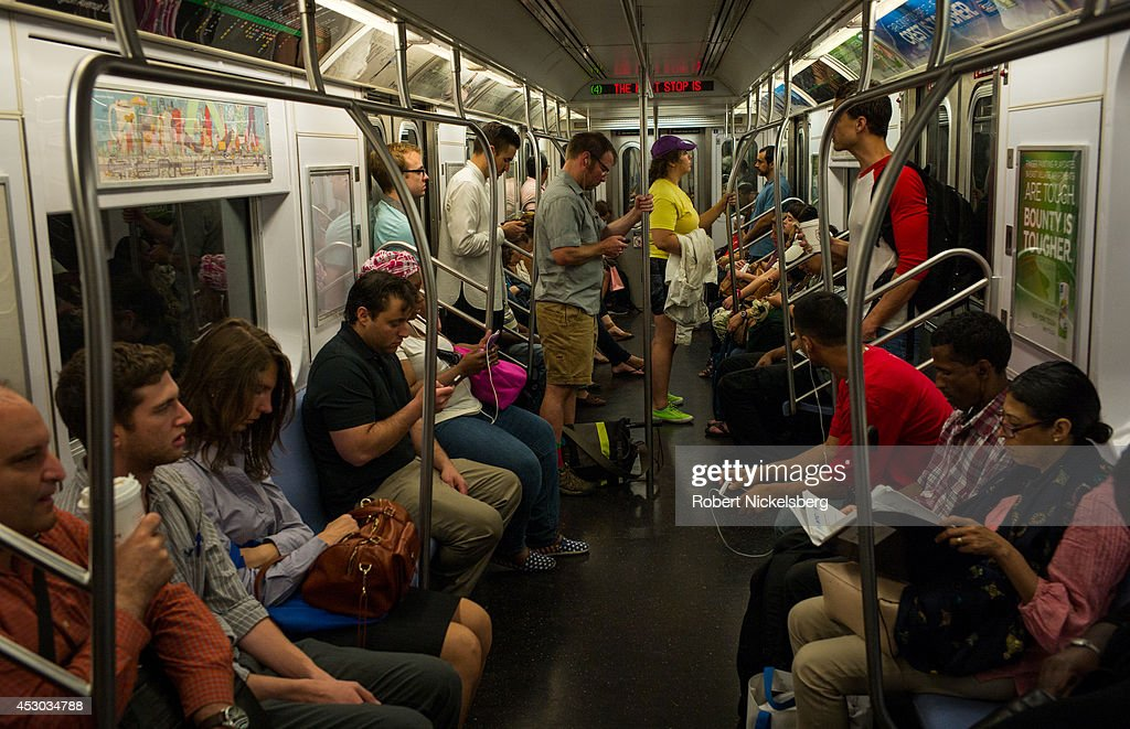 Passengers ride in a Metropolitan Transportation Authority subway car July 16, 2014 in the Manhattan borough of New York.