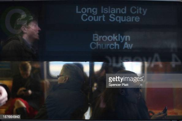 Passengers ride in a subway car two days after a man was pushed to his death in front of a train on December 5 2012 in New York City The incident was...