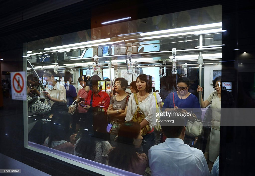 Passengers ride on a subway train in Shanghai, China, on Monday, July 1, 2013. China's President Xi Jinping said officials shouldn't be judged solely on their record in boosting gross domestic product, the latest signal that policy makers are prepared to tolerate slower economic expansion. Photographer: Tomohiro Ohsumi/Bloomberg via Getty Images