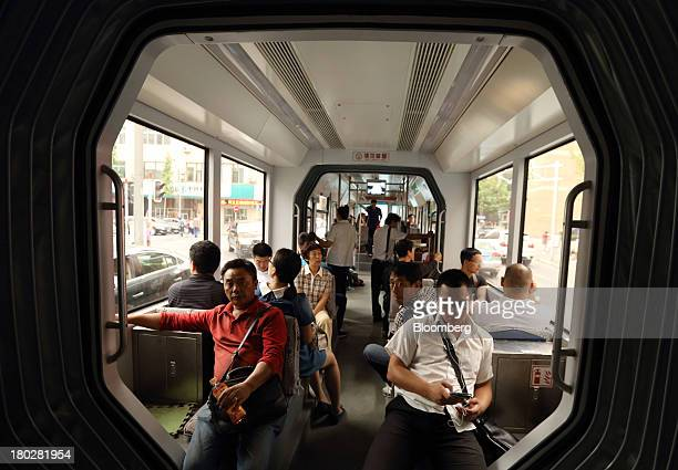 Passengers ride on a tram in Dalian China on Tuesday Sept 10 2013 Goldman Sachs Group Inc last week raised its estimate for China's economic growth...