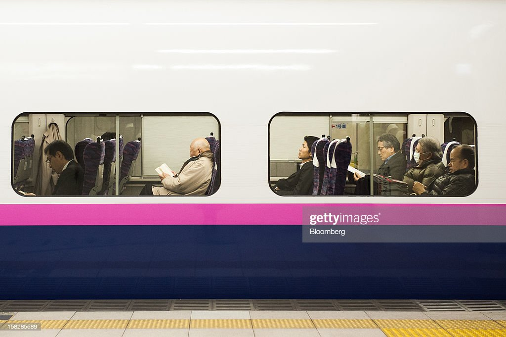 Passengers ride on an East Japan Railway Co. Shinkansen bullet train at a station in Tokyo, Japan, on Monday, Dec. 10, 2012. Japan's economy shrank in the last two quarters, meeting the textbook definition of a recession, as the dispute with China, the country's biggest export market, caused consumers there to shun Japanese products and contributed to Japan's worst year for exports since the global recession in 2009. Photographer: Noriko Hayashi/Bloomberg via Getty Images