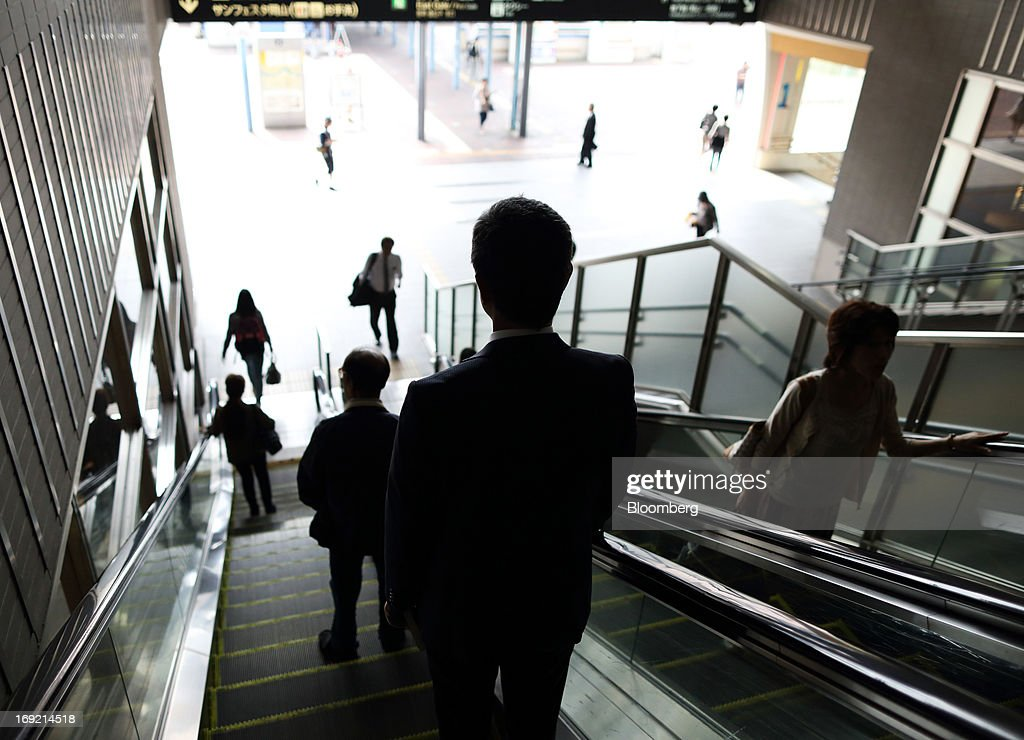 Passengers ride on escalators at Okayama train station in Okayama, Japan, on Tuesday, May 21, 2013. The Bank of Japan, forecast to maintain plans for expanded monetary easing at a meeting ending on May 22, is targeting 2 percent inflation in two years after more than 10 years of entrenched deflation. Photographer: Tomohiro Ohsumi/Bloomberg via Getty Images