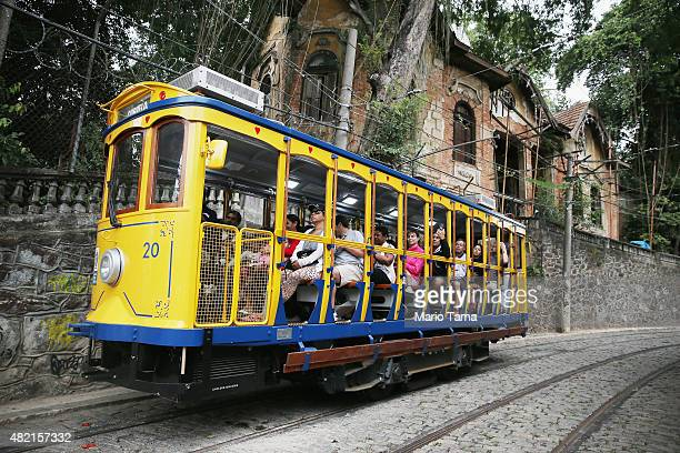 Passengers ride on the first day of preoperations on the partially reopened Santa Teresa tram line or 'bonde' on July 27 2015 in Rio de Janeiro...