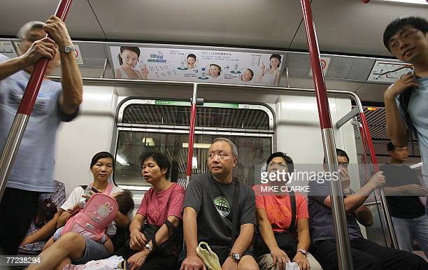 Passengers ride the Mass Transit Railways in Hong Kong 09 October 2007 Shares of Hong Kong's largest railway operator MTR Corporation were suspended...