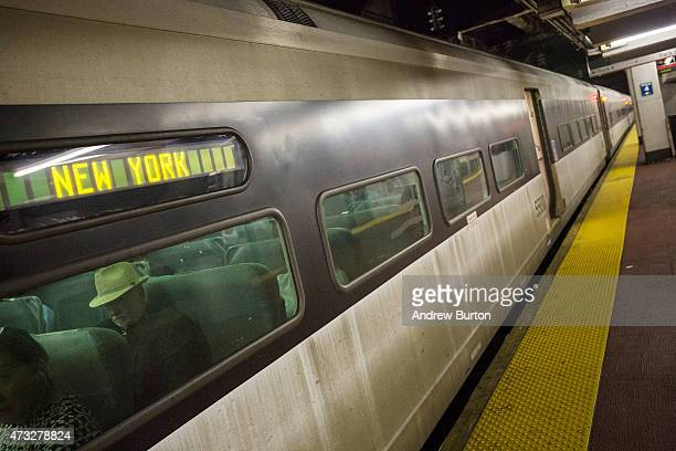 Passengers ride the NJ Transit train from New York Penn Station to Trenton NJ on May 14 2015 in New York City An Amtrak train crash in Philadelphia...
