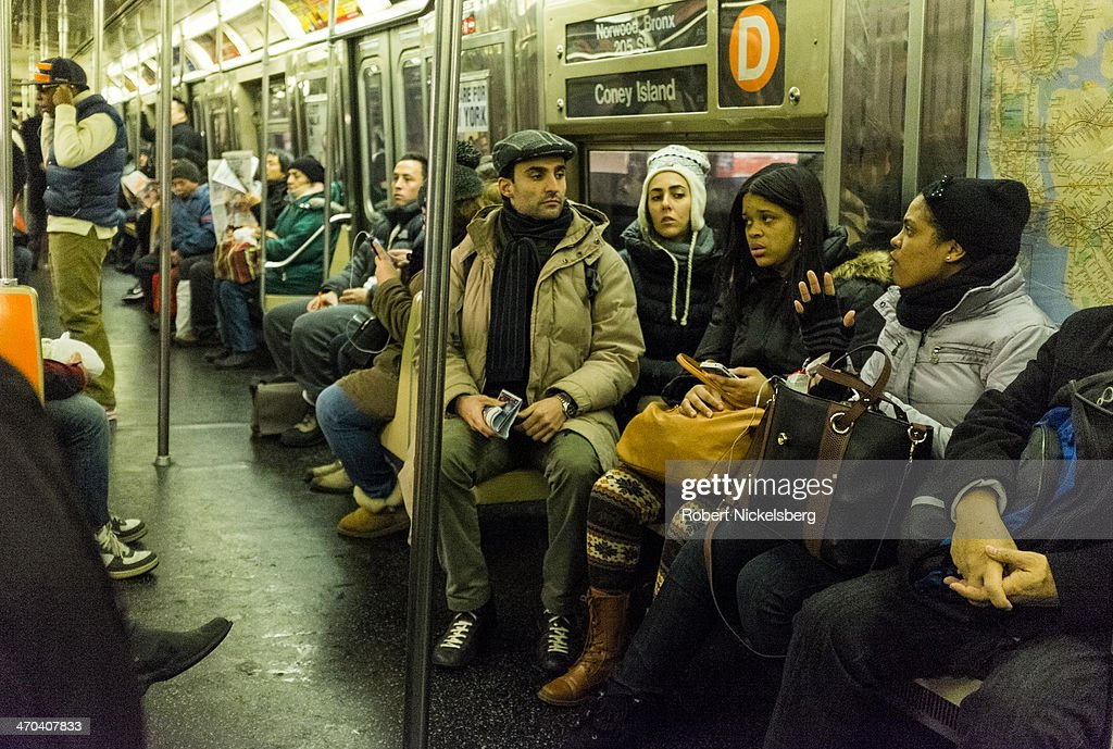 Passengers ride the subway January 10, 2014 in the Manhattan borough of New York.