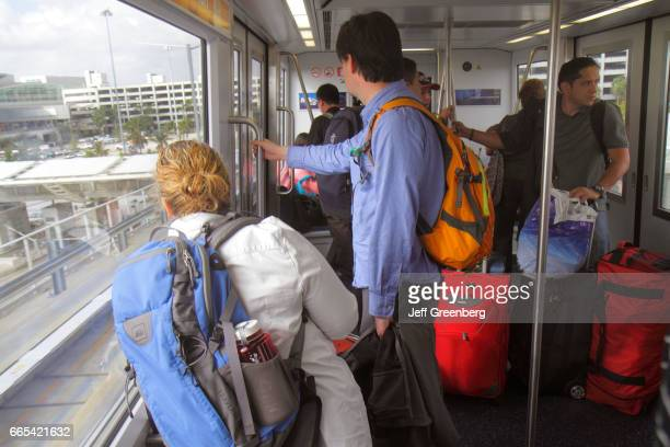Passengers riding the MIA Mover SkyTrain at Miami International Airport