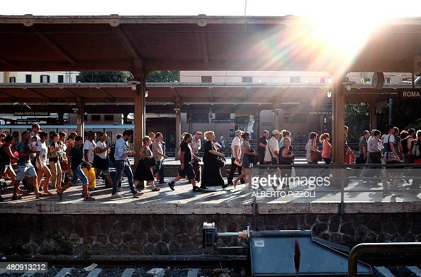 Passengers run to another train after the departure track was changed at a Rome subway station on July 15 2015 For the past several days the Rome...