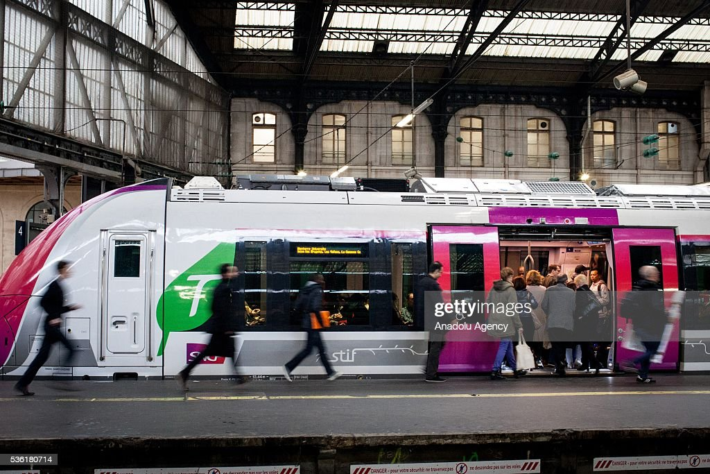 Passengers run to take the train just arrive at Paris Saint-Lazare Train Station, Paris, France on May 31, 2016.