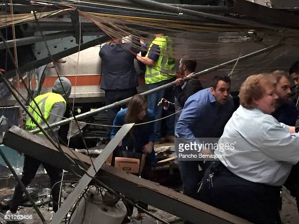 Passengers rush to safety after a NJ Transit train crashed in to the platform at the Hoboken Terminal September 29 2016 in Hoboken New Jersey New...