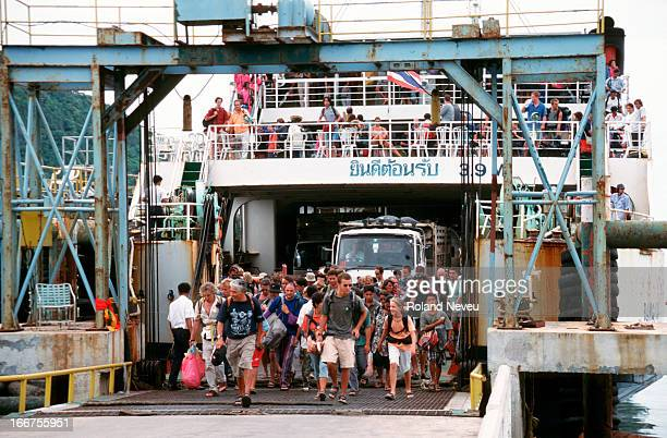 Passengers rushing out of a ferry at Samui pier Thailand