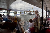 Passengers sit aboard a ferry boat on the Bosporus Strait in Istanbul Turkey on Wednesday July 20 2016 Moody's Investor Services said Monday that...