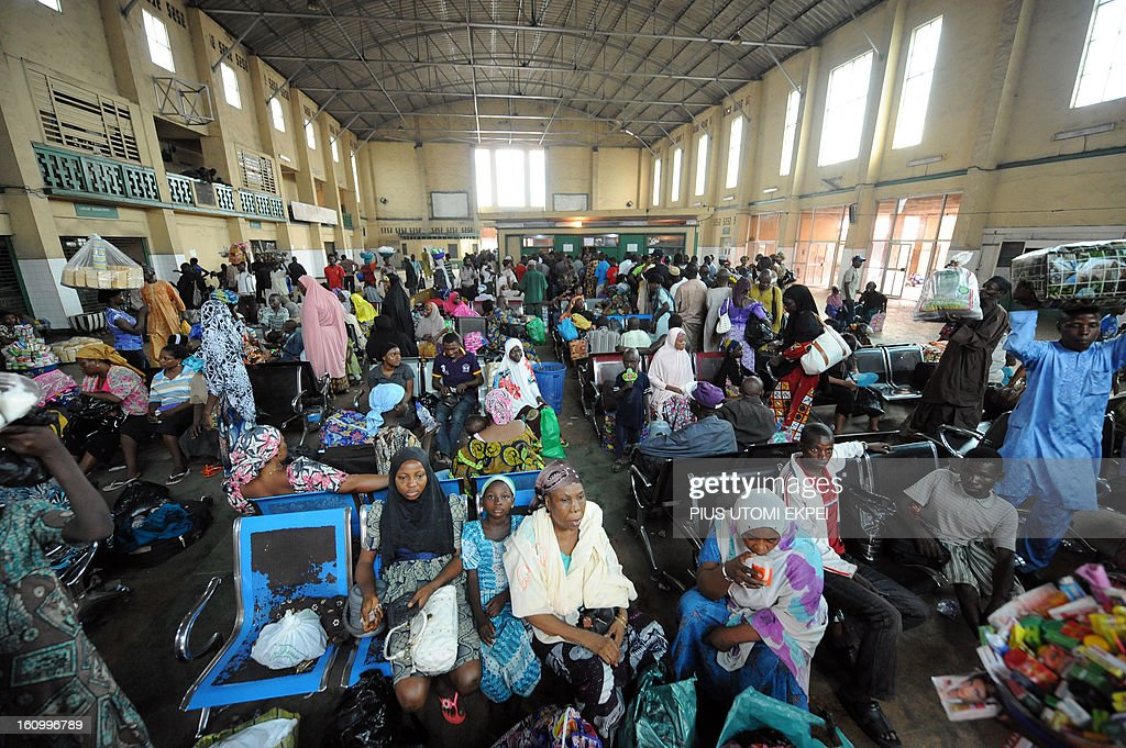 Passengers sit at the departure hall of Lagos Terminus of the Nigerian Railway Corporation on February 8, 2013. The rejuvenated Nigerian Railway Corporation has commenced operation of mass transit on the Lagos-Kano route, Nigeria's major commercial cities. The state-owned corporation which went into bankruptcy during the last 20 years due to lack of maintenance of infrastructure and high numbers of employees also began haulage of petroleum products from Lagos to the north of the country. Earlier last year, the Railway Corporation had acquired 20 pressurised tank wagons as it prepared to commence the fuel haulage. The 20 wagons have the capacity to lift 900,000 litres of petroleum products, the equivalent of 27 road tankers.