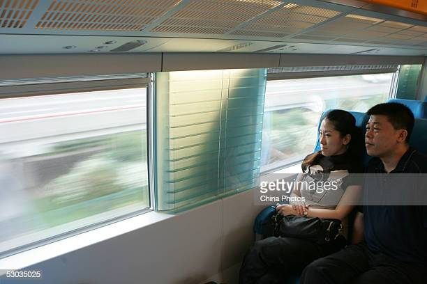 Passengers sit in a running Maglev train also known as the magnetic levitation train on June 7 2005 in Shanghai China Shanghai boasts the world's...