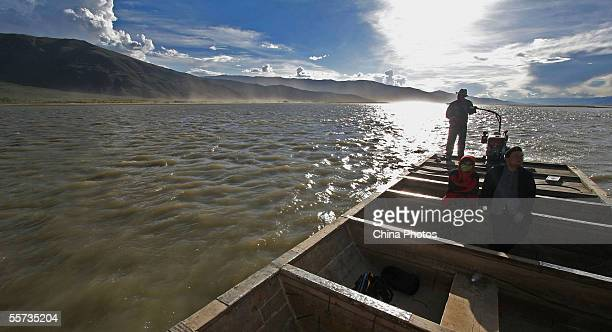 Passengers sit on a ferry on the Brahmaputra River also known as the Yaluzangbu River on September 20 2005 in Zhanang County of Tibetan Autonomous...
