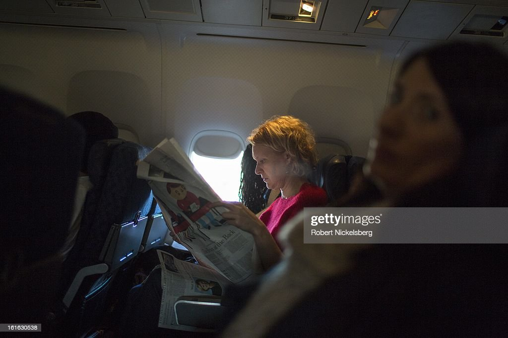 Passengers sit on an American Airlines flight February 3, 2013 from Los Angeles International Airport in Los Angeles, California to New York's JFK Airport.