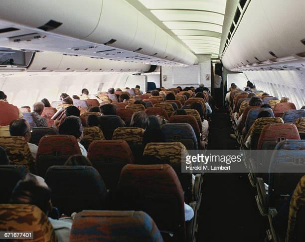 Passengers Sitting In Aeroplane