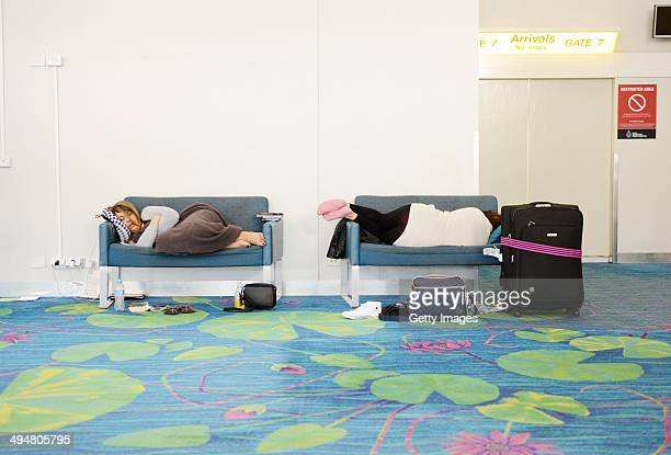 Passenger's sleep in Darwin airport on May 31 2014 in Darwin Australia Flights in and out of Darwin have been suspended as volcanic ash from Mount...