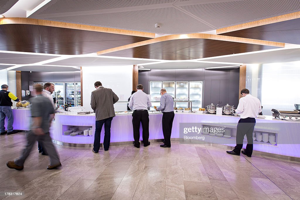 Passengers stand at a buffet in the Virgin Australia Holdings Ltd. lounge at the domestic terminal of Sydney Airport in Sydney, Australia, on Thursday, Aug. 29, 2013. Virgin will make a net loss in the range of A$95 million to A$110 million when it reports annual results tomorrow, the Brisbane-based carrier forecast Aug. 5. Photographer: Ian Waldie/Bloomberg via Getty Images
