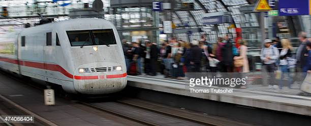 Passengers stand at a platform while a ICE train arrives at Berlin Central Station on May 20 2015 in Berlin Germany Germany's labor union of train...