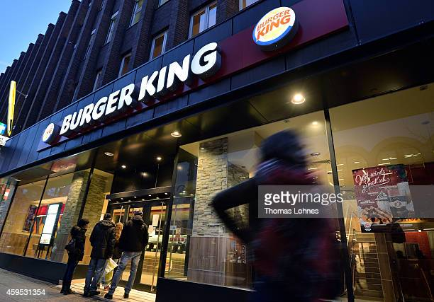 passengers stand for a temporary closed Burger King restaurant on November 24 2014 in Frankfurt Germany It is of the 89 Burger King restaurants...