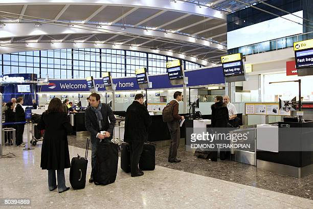 Passengers stand in line to check in on March 27 2008 at the London Heathrow Terminal 5 which opened today to passengers The first ever passengers to...