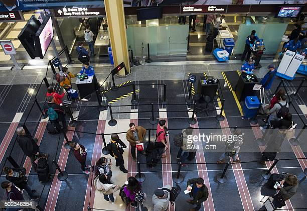 Passengers stand in line to go through a TSA security checkpoint as they head to their flights at Reagan National Airport in Arlington Virginia...