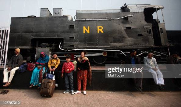 Passengers stranded at the New Delhi Railway station wait for further communication after several trains were either delayed or cancelled due to...