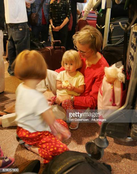Passengers Sue Larson from Ealing with daughters Charlotte and May at Heathrow's Terminal 4 as British Airways suspended all checkin for its flights...