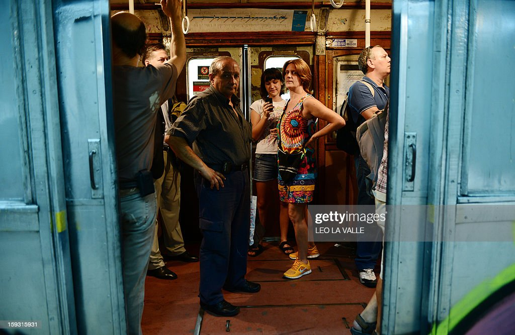 Passengers take one of the Le Burgeoise wagons of the A Line subway, at Plaza de Mayo station, in Buenos Aires, on January 11, 2013 during the so called last ride of the historic trains. The Line A will be closed betwen January 12 and March 8 following a decision by Buenos Aires city Mayor Mauricio Macri to replace the fleet with Chinese-made wagons. Line A was the first subway line to work in the southern hemisphere and its trains are among the ten oldest still working daily. The La Brugeoise wagons were constructed between 1912 and 1919 by La Brugeoise et Nicaise et Delcuve in Belgium. AFP PHOTO/Leo La Valle
