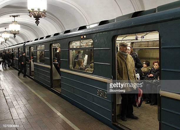 Passengers travel aboard a subway train at the Komsomolskaya metro station in Moscow Russia on Tuesday Nov 23 2010 Russia's government plans to sell...