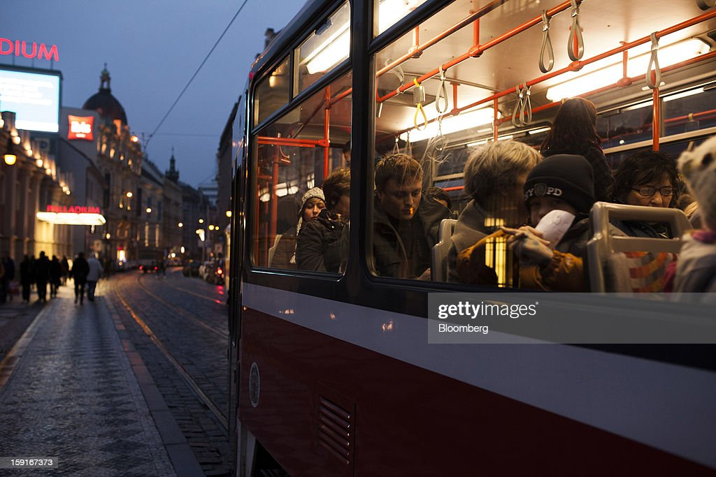 Passengers travel on a public tram at night through the center of Prague, Czech Republic, on Tuesday, Jan. 8, 2013. The Czech economy is showing weak domestic demand as households and businesses cut spending due to government austerity programs and the euro area's debt crisis. Photographer: Bartek Sadowski/Bloomberg via Getty Images