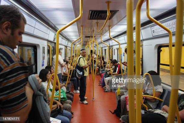 Passengers travel on an underground train in the city centre on July 4 2012 in Madrid Spain Despite having the fourth largest economy in the Eurozone...