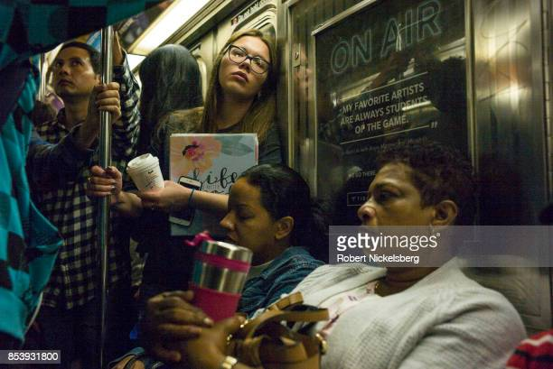 Passengers travel on the subway in New York City New York September 17 2017 The New York subway system faces a deteriorating infrastructure with...