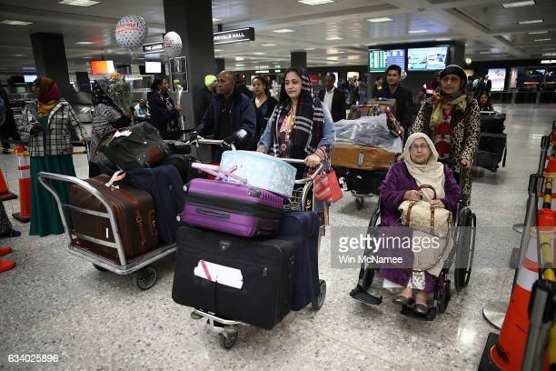 Passengers traveling on a flight from Addis Ababa Ethiopia arrive at the international arrivals area of Dulles International airport on February 6...