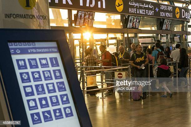 Passengers undergo security check at Ben Gurion International airport near the Mediterranean Israeli coastal city of Tel Aviv on August 21 following...