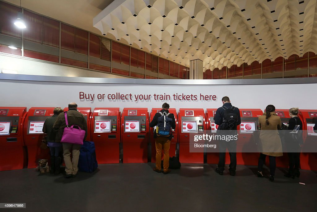 Passengers use self service ticket machines at Euston railway station in London, U.K., on Thursday, Nov. 27, 2014. Virgin Trains and partner Stagecoach Group Plc were chosen to run the London-Edinburgh rail route, fending off rival bids from FirstGroup Plc and Eurostar International Ltd. and delivering a boost for Richard Branson a month after the fatal crash involving his space venture. Photographer: Chris Ratcliffe/Bloomberg via Getty Images