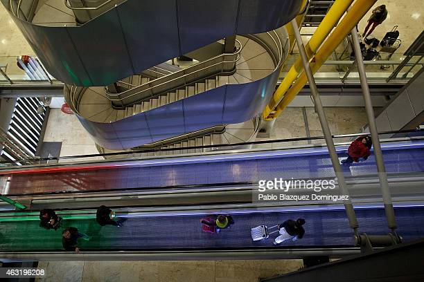 Passengers use the escalator at Madrid Barajas Adolfo Suarez airport which is operated by group Aena on February 11 2015 in Madrid Spain Shares in...