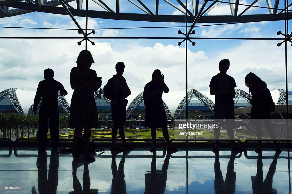 Passengers view the new Suvarnabhumi Airport from inside the baggage claim area after arriving on a domestic flight