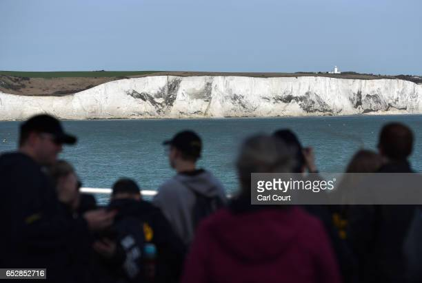 Passengers view the White Cliffs of Dover as they cross the English Channel on a ferry on March 13 2017 in Dover England The White Cliffs of Dover...