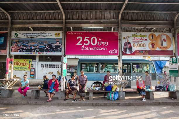 Passengers wait at a bus station in Vientiane Laos on Thursday Nov 2 2017 Located in the Mekong region Southeast Asia's frontier nations are stepping...