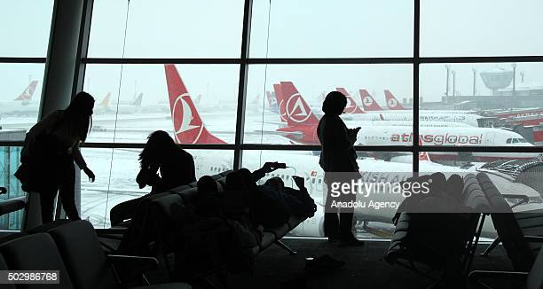 Passengers wait at Ataturk Airport in Istanbul Turkey on December 31 after announcement of further flight cancellations due to adverse weather While...