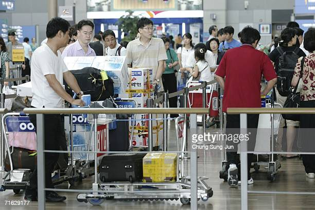 Passengers wait at Incheon International Airport on August 11 2006 in Incheon South Korea South Korea tightened security checks Thursday on flights...