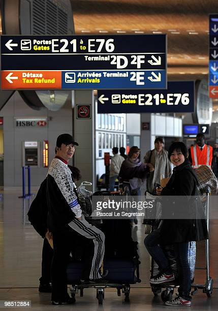 Passengers wait at Roissy CharlesdeGaulle terminal E after airports including Charles de Gaulle and Orly were closed while wind continues to blow ash...