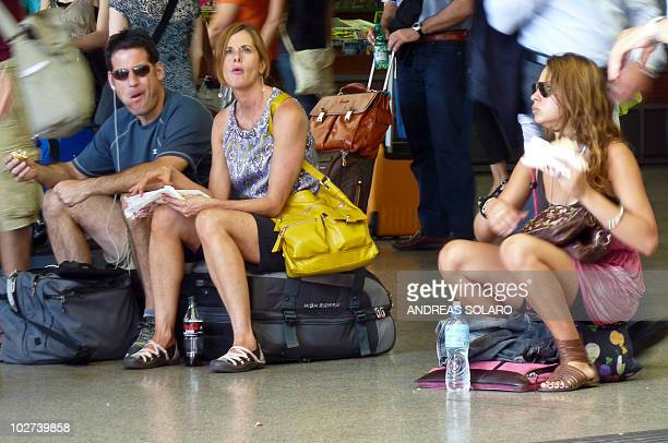 Passengers wait at Rome Termini station during a national transport strike in Rome on July 9 2010 A national 24hour transport strike called by...