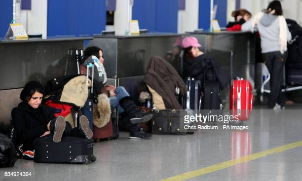 Passengers wait at Ryan Air checkin desks at Stansted Airport Essex following a protest by direct action group Plane Stupid