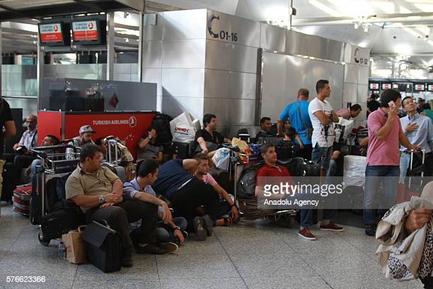 Passengers wait at the Ataturk Airport as the crowding due to the flight cancellations because of the failed coup attempt continues in Istanbul...