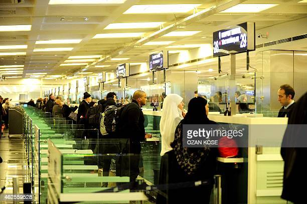 Passengers wait at the passport control check desk of the international airport in Istanbul on January 29 2015 The country has long been under...